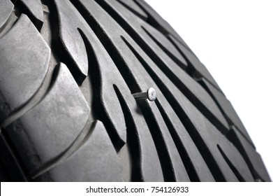 Close up of tire with nail