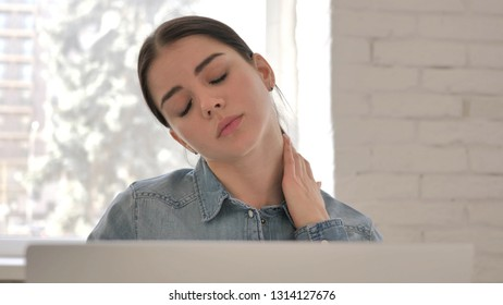 Close Up of Tired Young Girl with Neck Pain at Work