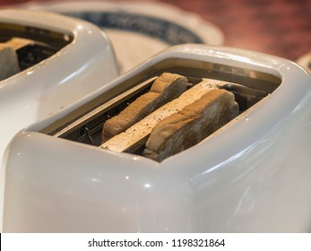 Close up of a toaster with bread in ready to pop up
