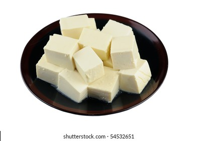 Close up of tofu on plate isolated on white