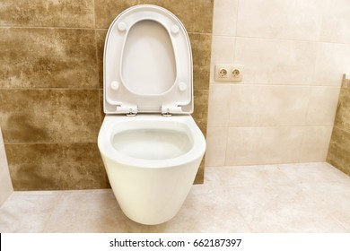 Close up of toilet bathroom interior with white ceramic seat