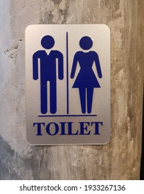 Close up of toilet sign on wall