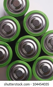 close up the top of  AA battery,color on green.