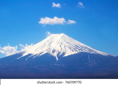 Close up top of beautiful Fuji mountain with snow cover on the top with could, Japan