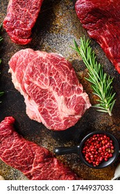 Close up top blade steak cutwith set of different alternative types of raw beef steaks on a rustic metall background top view layflat