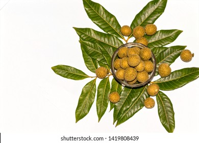 Close up and top or high angle view of fresh ripe longan or Dimocarpus longan fruits in a glass bowl on white isolated background.