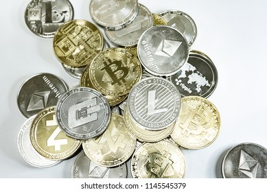 Close up of top important cryptocurrencies which dollar bank note in background. which including of Bitcoin, Ethereum, Litecoin, Dash, Zcash and Ripple coin. Business and financial of cryptocurrency.