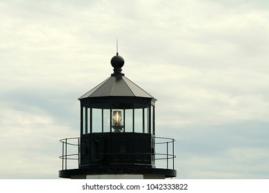 A close up of the top of Marshall Points light house with the light showing.  Image was taken late evening with a telephoto lens and a tripod. Marshall Point can be found in Maine.