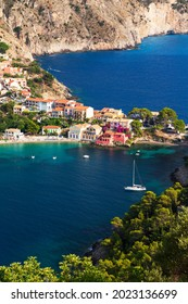 Close up top view at Asos village, Assos peninsula and fantastic blue Ionian Sea water. Aerial view, summer scenery of famous and extremely popular travel destination in Cephalonia, Greece, Europe.