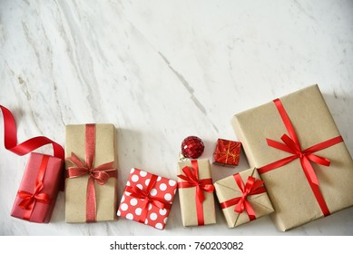 Close up Top view of Brown, white and Red gift boxes on white marble background for Christmas and New year.