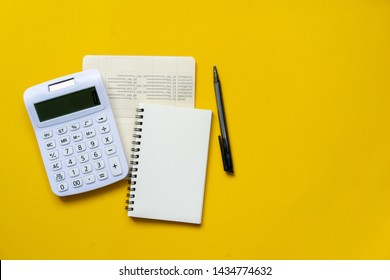 close up top view of calculator,book bank ,notebook and pencil for counting and planning about monthly expenses at home for retirement lifestyle concept