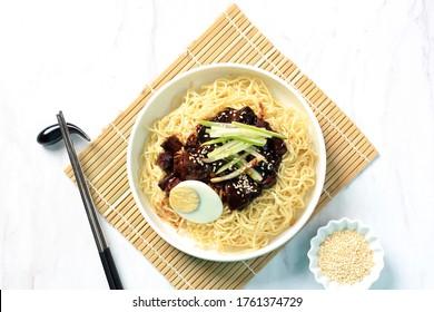 Close Up Top View  Jajangmyeon or JJajangmyeon  is Korean Noodle with Black Sauce on White Background