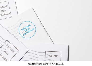 Close up top view Postage paid Australia mail or letter on white background with copy space.