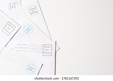Close up top view Postage paid Australia letter on white background with copy space.