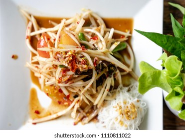 close up top view Thai Spicy Green Papaya Salad with pickled fish delicious Thai food Cuisine, Som Tum puu pla ra, close up