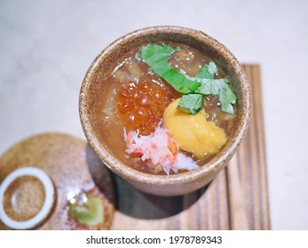 Close up top view traditional Asian culture high class fine premium classic authentic Japanese appetizer steamed egg custard topped with ikura salmon roes, uni sea urchin, Taraba King crab meat