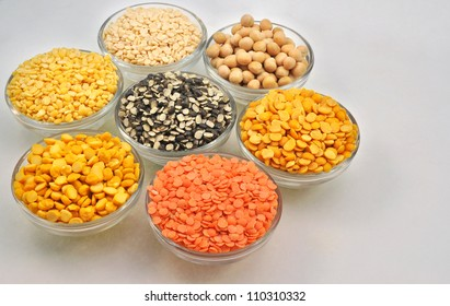 close up top view of variety of husked pulses kept in glass pots