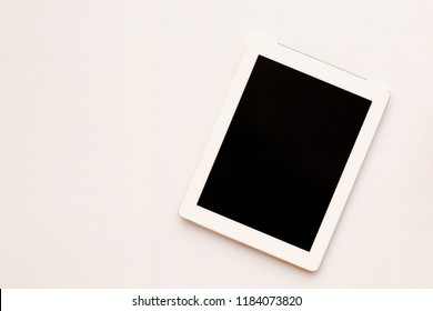 Close up top view to white tablet computer isolated and Empty blank screen black on white background view. Flat lay creative ideas with blank mock up. Front view of the Business.