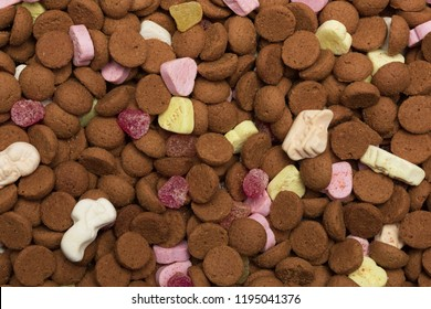 Close up topview of dutch candy pepernoten, brown background image