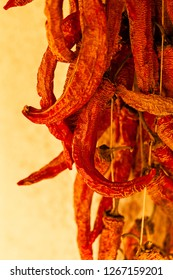 Close up traditional autumn dried peppers and their texture; note shallow depth of field