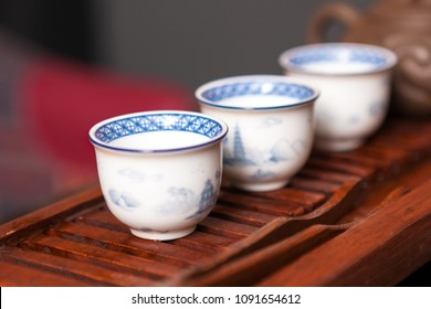 Close up of traditional chinese porcelain teacups.