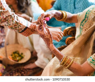 close up of traditional Hindu wedding hands with henna tattoo