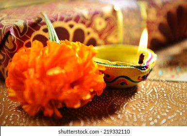 Close up of traditional indian oil lamp glowing against gift box background