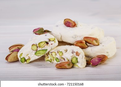 Close up Traditional Iranian and Persian pieces of white nougat dessert sweet candies (Gaz) with Pistachio nuts from Isfahan City