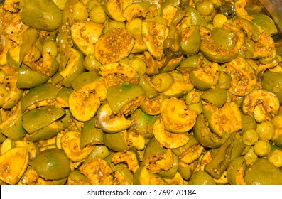 Close up of traditional Pakistani and Indian mango and gum berry pickle which is called aam  and lasooda ka achar or kairi ka achar in local language.