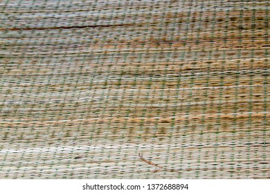 Close up of traditional reed woven sleeping mat in rural Vietnam.
