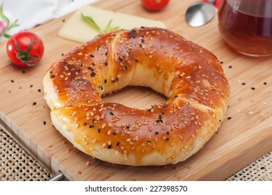 Close up of traditional Turkish bagel acma with cheese and tomatoes