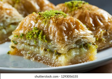 Close up Traditional turkish dessert antep baklava with pistachio on white plate. Desserts concept