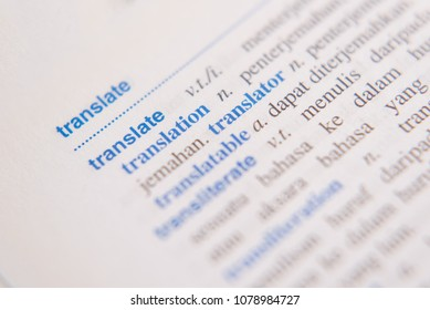 close up of a TRANSLATE word in a dictionary. english to malay dictionary. translator and language concept
