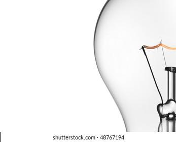 Close up of a transparent light bulb over a white background.