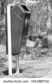 close up of a trash can in the park in black and white monochrome streetart