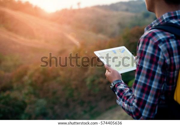 close up traveler man looking location on tablet,man reading map