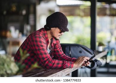Close up  Traveller using smartphone