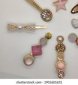 close up of trendy pearl diamond geometric hair clips pins