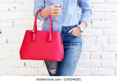 Close up trendy woman with red big bag and accessory watch. Fashion concept