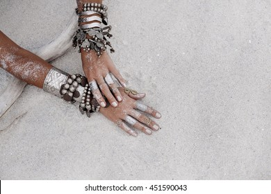 close up of tribal woman hands with bracelets
