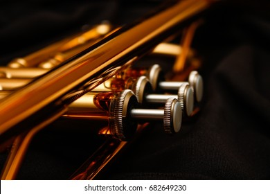 Close up of trumpet valves.
