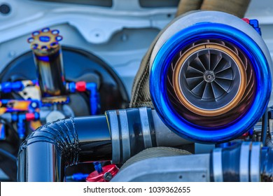Close up of Turbo charger installed on car engine for power booster torque drive, Turbo car engine showing inner parts and turbine Compressed air in car.