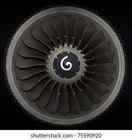 close up of turbojet of aircraft on black background