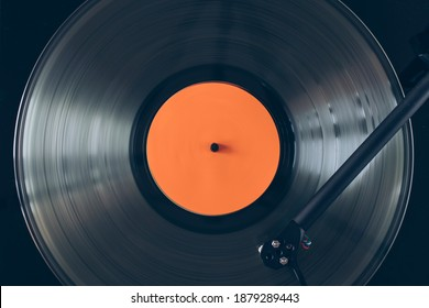 Close up of turntable tonearm playing vinyl record