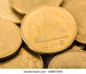 close up of two baht coins, a gold medal,Macro photography.