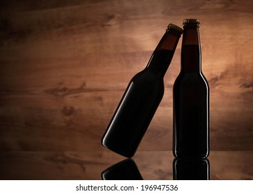 Close up of two beer bottles on wooden texture