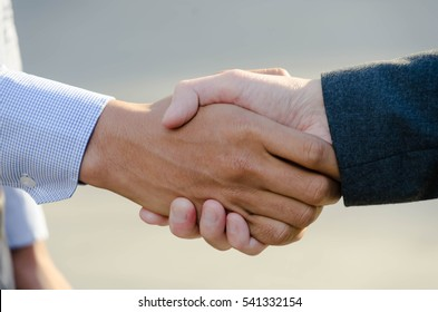 Close up of Two business men shaking hands
