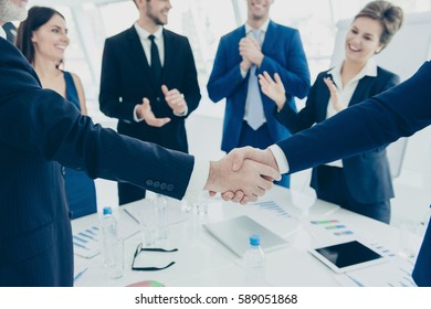 Close up of two business partners shaking hands  for signed contract.