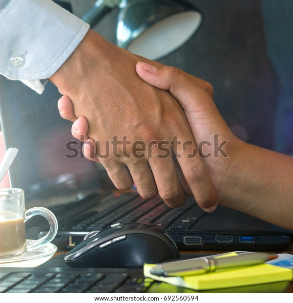 Close up two businessman shaking hands
