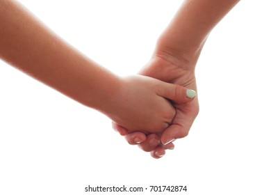 Close up of two children holding hands against a white background